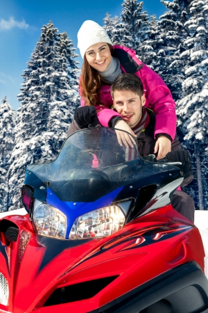 snowmobile:  Young couple on snowmobile