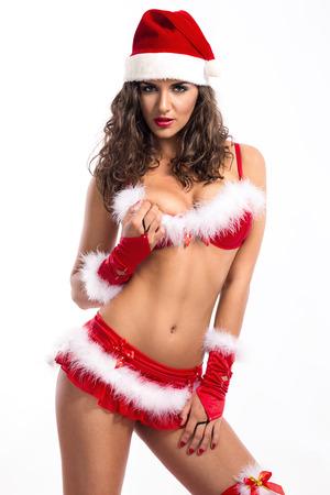 Attractive Santa girl posing in red  erotic lingerie photo