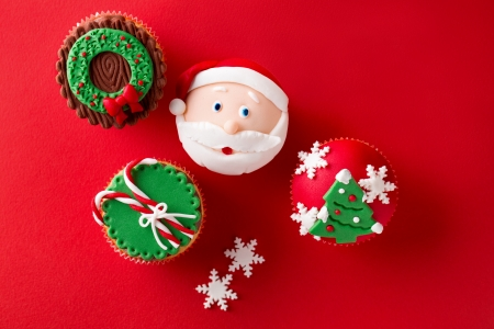 food still:  Christmas theme cupcakes in traditional red green colors and candy elements from overhead