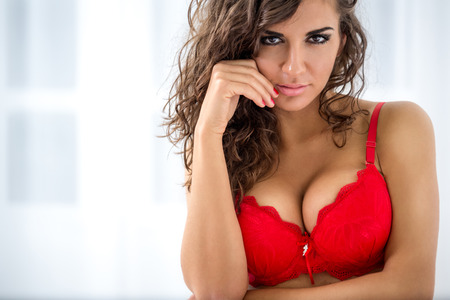 Portrait of young sexy woman in red bra photo