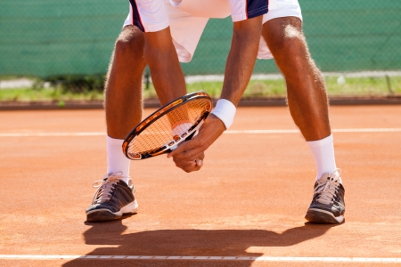 tennis players legs in position for waiting tennis ball photo