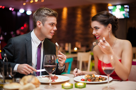dinner couple:  romantic couple in love on dinner in restaurant