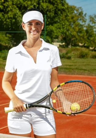 Young sporty woman with racket photo