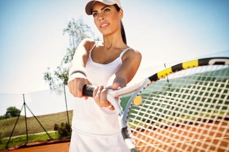 sporty girl tennis player with tennis racket photo