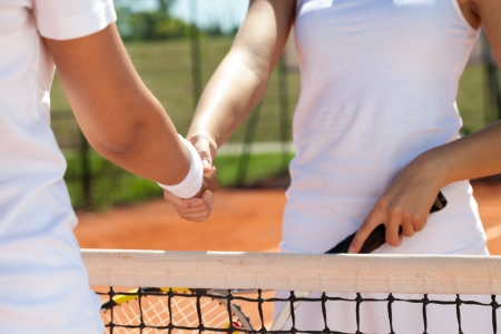Handshake at a tennis match, congratulations after win photo