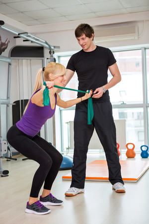 Woman doing  exercise with rubber bands photo