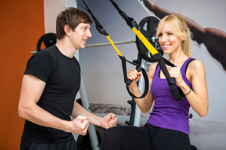 Sportswoman exercising with a resistance band at gym photo