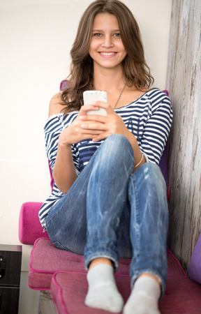 send sms:  Happy teenager  girl with smart phone
