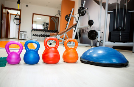 Gym equipment kettle bell and stepper  photo