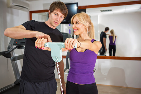 measured:  Individual fitness instructor  with client read-off measured result  Stock Photo