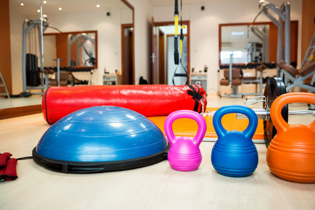 kilos:  Kettlebells at fitness gym with stepper