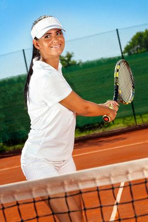 Cute young girl practicing tennis photo