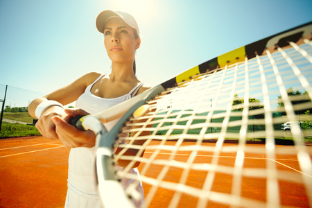 outdoor training:  Beautiful sporty girl playing tennis very passionately
