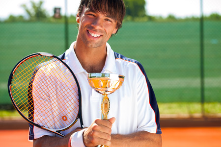 successes:  Happiness tennis player with medal and goblet