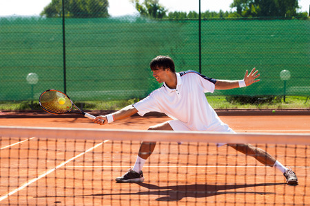 individual sport:  Handsome young man playing tennis