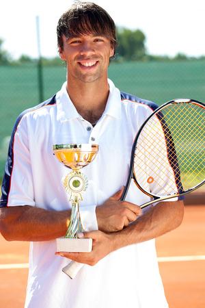 successes: giocatore di successi tennis con trofeo, competizione sportiva
