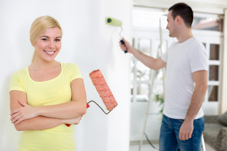 painting and decorating: young couple painting home