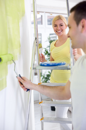 painting and decorating: Smiling couple renovation home