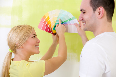 swatches: Smiling young couple with color samples