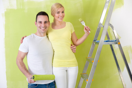 Young love couple together painting home photo