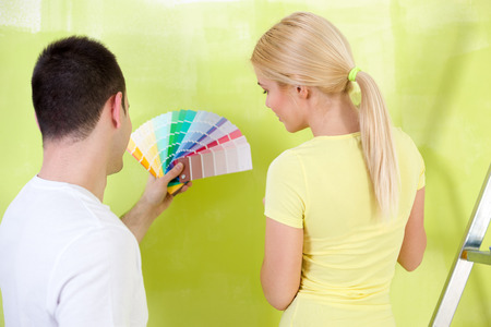 man painting: couple  with color samples to paint, back view Stock Photo