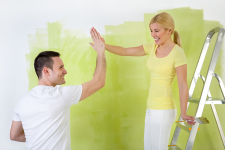 good work:  Teamwork, young couple  as painter workers , doing good work  Stock Photo
