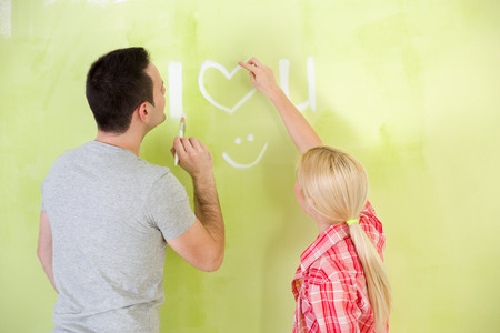 Love couple painting together their home photo