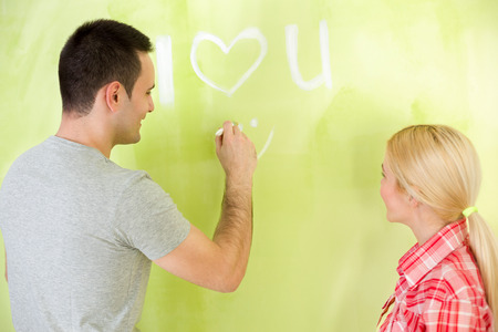Romantic love couple renovating house photo
