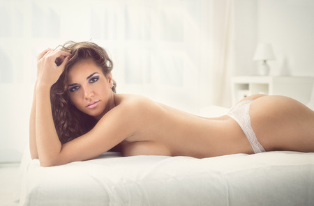 Erotic woman lying on her stomach in panties photo