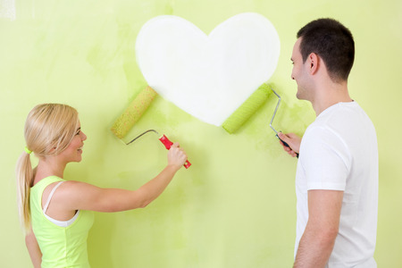 Love couple at heart painting on wall photo