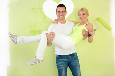 Happy love couple painting apartment photo