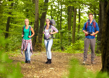 young people walking in forest. photo