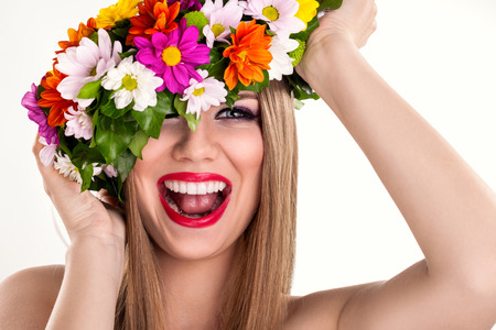 Happiness woman laughing and playing with flower wreath