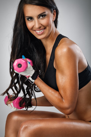Fitness woman doing exercise with dumbbells Stock Photo - 28444882