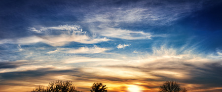 beautiful sunset sky  with dramatic clouds - panorama photo