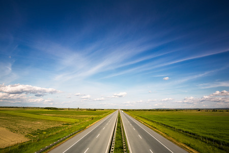 highway with beautiful fields on both sides  Stock Photo