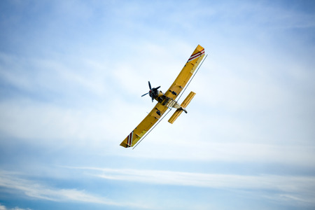 piper:  beautiful yellow aircraft is flying in the sky