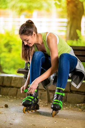 Young attractive girl is preparing to ride the roller photo