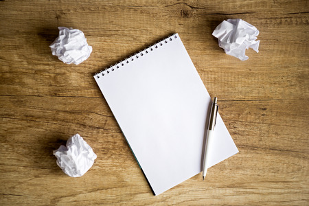 no idea:  concept - no idea , Empty notebook on wooden table with crumpled papers around