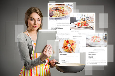 cooking icon: young woman cooking using the tablet, cloud of colorful social media icons out of tablet pc