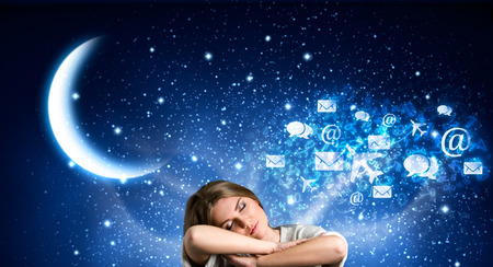 Young girl sleeping surrounded by abstract elements of her dreams photo