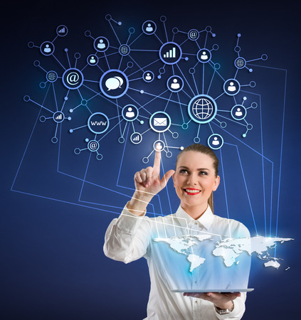 Smiling businesswoman  with tablet and  virtual icons photo