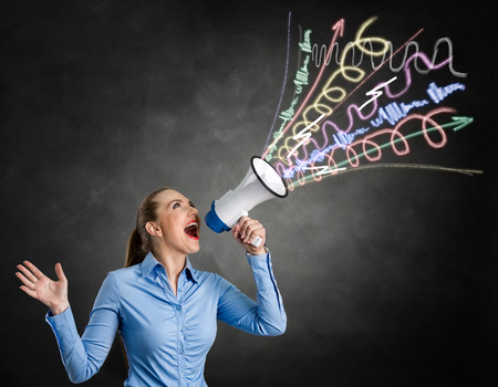 Angry girl shouting into megaphone with hand drawn lines and arrows on grungy background photo