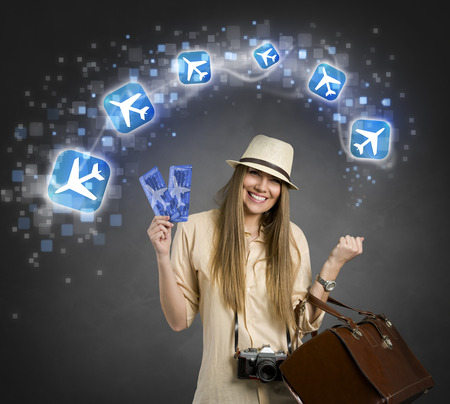airplane ticket  ,Cheerful female tourist with planes icon,  photo