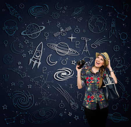 Excited woman with retro photo camera looking at draw space photo