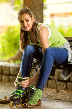 rollerblades:  Attractive young girl with rollerblades in park  Stock Photo