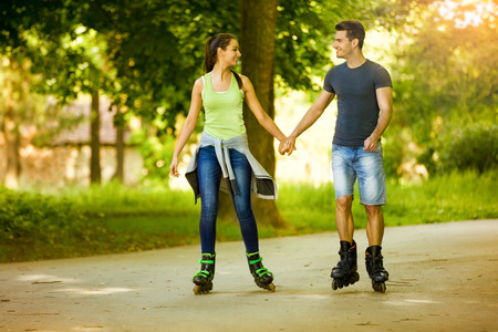 happiness couple roller-skating in park  photo