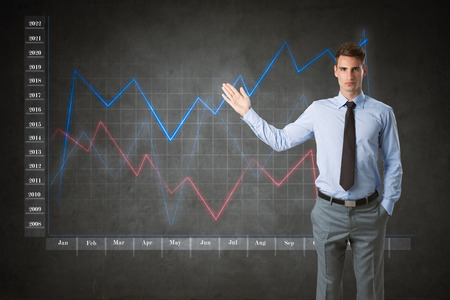 businessman with virtual finance graphic in background  photo