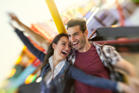 Laughing couple enjoy in riding ferris wheel- shoot with lensbaby photo