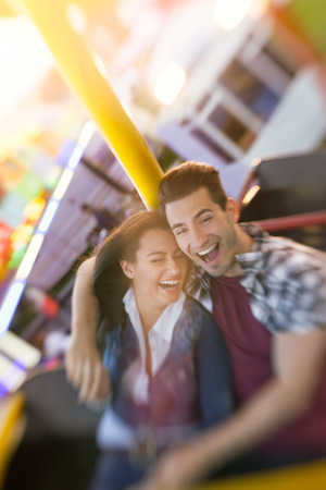 amusement park ride: Happy couple enjoy in riding ferris wheel in attractions park - shoot with lensbaby Stock Photo